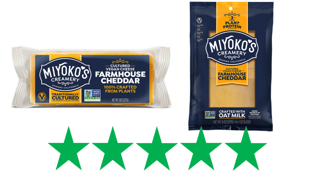 Miyoko's Farmhouse Cheddar – review & ethical rating. The image shows Miyoko's Farmhouse Cheddar (sliced and as a block) with an graphic of 5 Green Stars underneath, representing an ethical rating of 5/5.